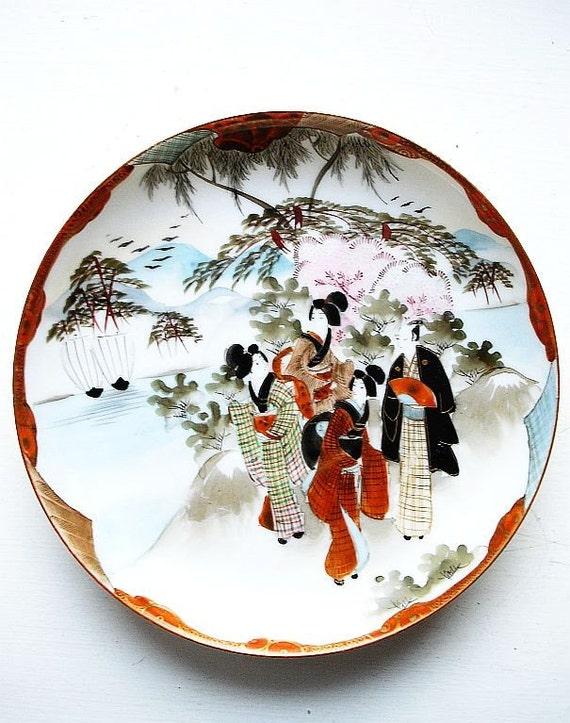 Vintage Kutani saucer - geisha and man