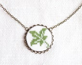 Hand embroidered necklace Leaf on white in bronze - n051