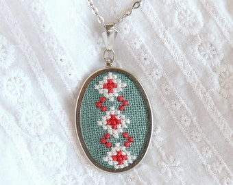 Hand embroidered necklace with ukrainian ornament white and red on green - n006