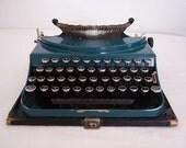 teal blue Remington pop up typewriter