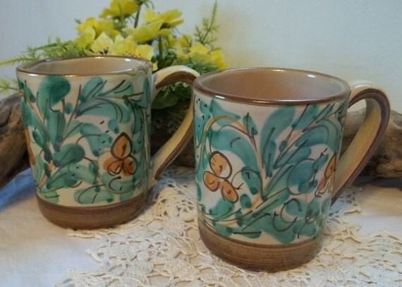 pair of hand painted in Mexico mugs