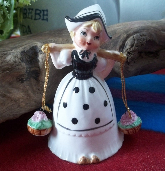 Super cute vintage hand painted dutch girl bell figurine with unique side clackers