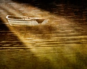 The Light Shines on a moored Boat - A Fine Art Photograph