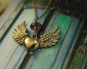 ON THE WINGS OF LOVE. Winged heart neckpiece