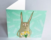 Easter bunny card, pack of 6 blank greeting cards, cute rabbit and daffodils illustration, spring green with yellow flowers.