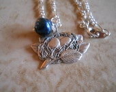 Birdnest charm necklace with navy shell Pearl 18 inch Figaro chain Sterling plated charm Item 280