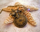 Bumble bee and clock charm necklace in Antique brass with Czech glass bead Item 182