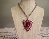 Dragon's Heart - Vintage Heraldic Sheild Pendant with Fiery Red Lucite Cabochon and Battle Axes signed Star