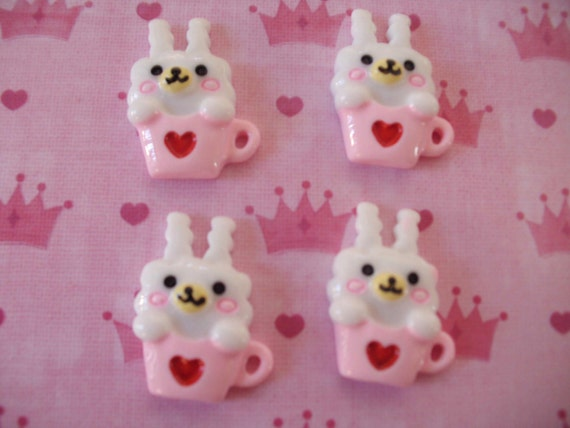 Cute happy bunny in a pink cup cabochons   4 pcs