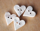 Light pink imprinted ceramic heart buttons
