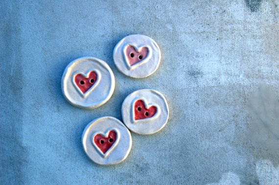 Round buttons with a heart