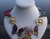 Flutter by Butterfly, a  necklace featuring repurposed butterfles, repurposed earrings, and a pendant