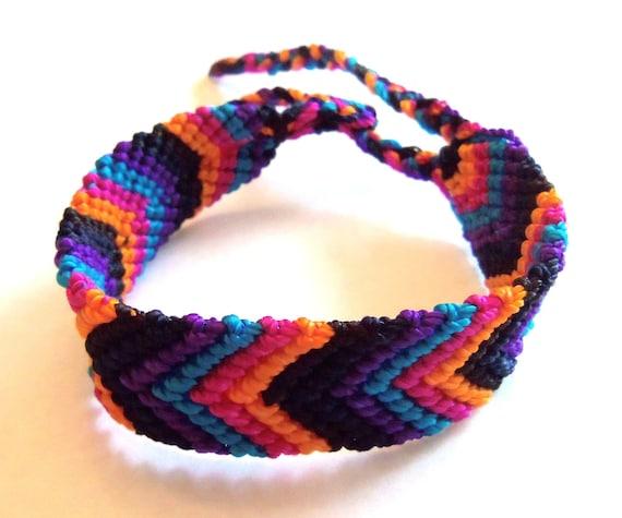 Knotted friendship bracelet, black, blue, purple, pink, orange