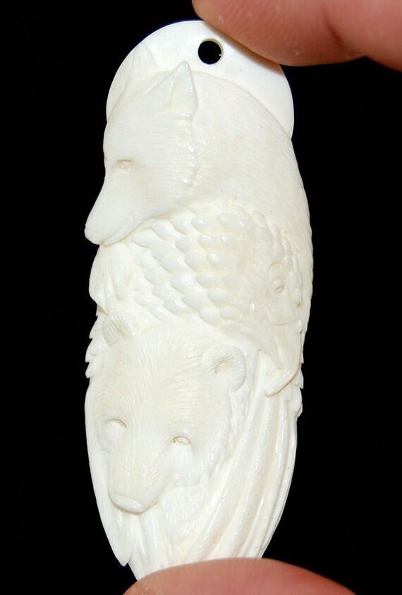 Hand carved bone Bear, Eagle and Wolf pendant bead BO9634