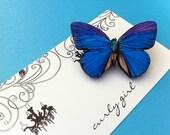 Decoupaged butterfly brooch in purple