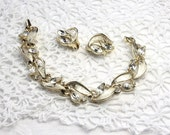 Lisner matching earrings and bracelet. Exquisite gold and clear rhinestone.