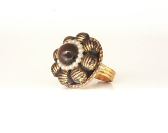 Vintage ring made from repurposed jewelry. Adjustable, beautiful and one of a kind.