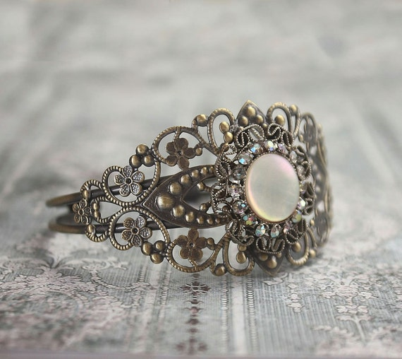 Recycled jewelry.  Vintage earring cuff bracelet . One of a kind. Free international shipping