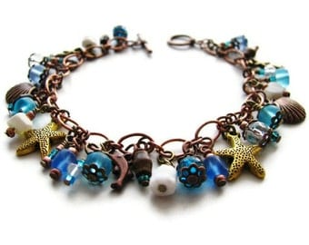 Shell and Starfish Charm Bracelet in Ocean Blue, Copper, and Brass Bohemian Beach Jewelry - Seaside
