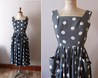 Vintage 1950s grey and white polka dots dress