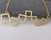 Linked squares necklace in gold