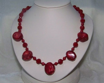 Bold red coral necklace with matching earrings