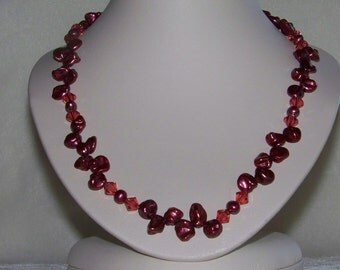 Unique rusty rose pearl and strawberry chrystal necklace with matching earrings