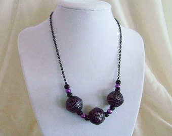 Purple passion.  Purple and black necklace w earrings.