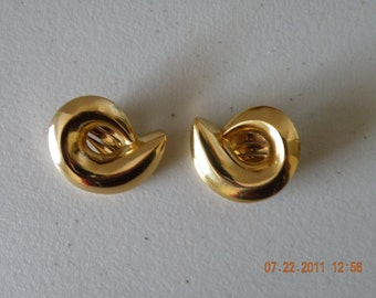 GIVENCHY Paris New York gold plated swirl clip - on earrings.  1980s