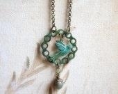 Rustic Necklace. Spring Fields. Brass flying hummingbird charm with verdigris patina and agate gemstone