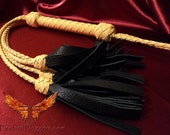 Yellow tassel tail flogger whip
