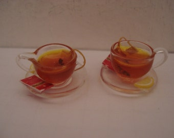 Miniature two cups of tea