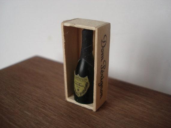 Miniature champagne Dom Perignon in wooden box