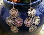 Metal lace earrings with a tiny bit of sparkle, in clear crystal