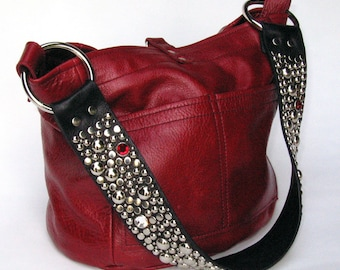 The Ball Buster bag in Red, stones and studs on shoulderstrap
