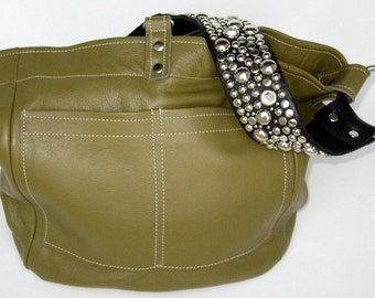 The Ball Buster bag in Olive, stones and studs on shoulderstrap