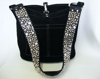 The Ball Buster bag in Black with natural stitch, stones and studs on shoulderstrap