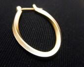 An amazing ellipse shaped, hoop 14k gold plated earrings