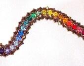 """BRACELET with a 26 color spectrum of Swarovski Bicones   """"Dorado Essence"""""""
