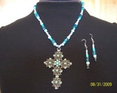 18 inch cross necklace with turqouise blue beads and matching earrings.