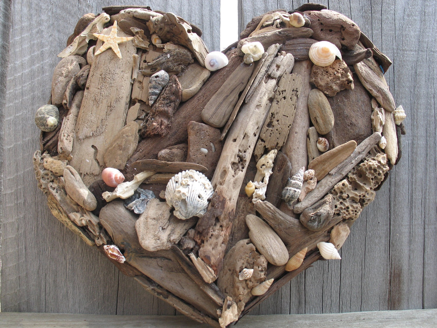 Rustic beach decor natural driftwood and sea shell heart made for What are shells made of