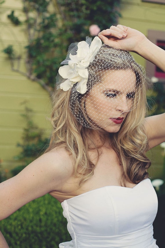 Cymbidium flowers with birdcage veil- orchid bridal fascinator