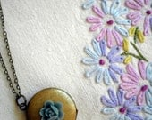 Rainy Day Locket - Antiqued Bronze Round Locket with Blue Flower Charm Necklace