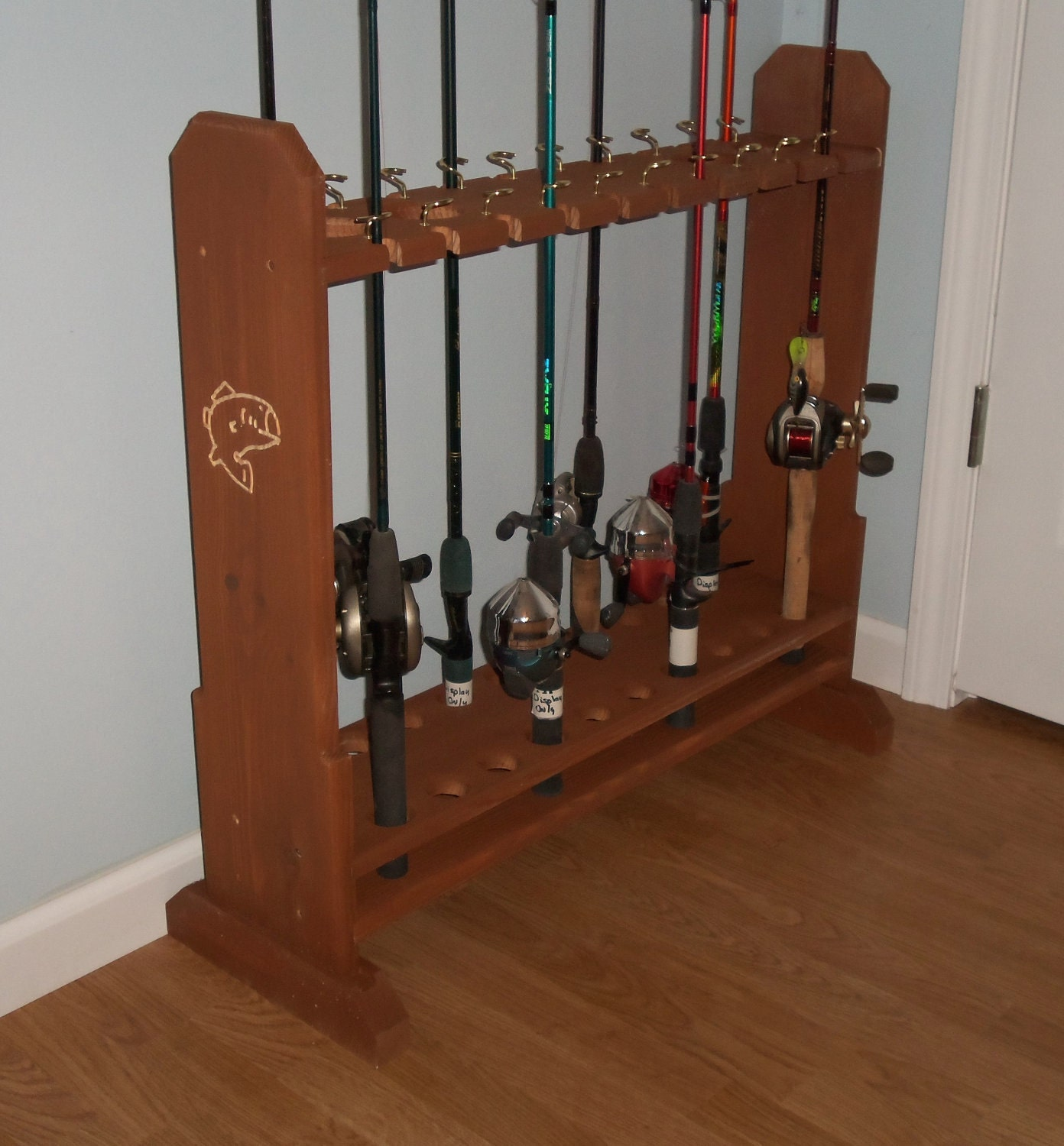 Unavailable listing on etsy for Fishing rod stand