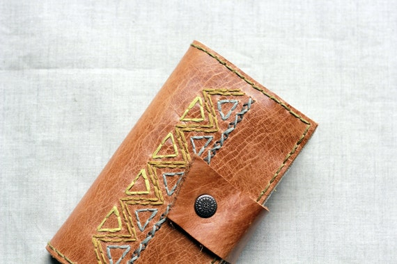 Embroided tan leather iphone wallet with a snap closure / 6 card pockets / cash compartment
