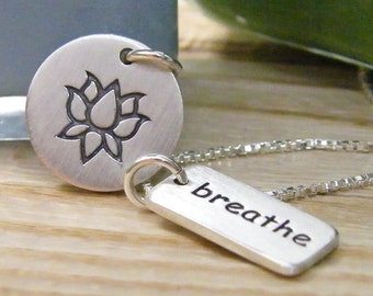 yoga necklace lotus flower and breathe word tag sterling silver in matte finish