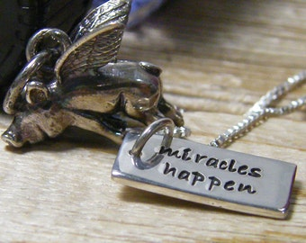 flying pig necklace  with hand stamped word tag miracles happen