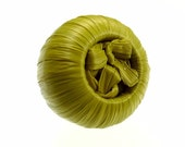 Chartreuse green button made of rafia