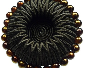 Buttons, brown thread and beads