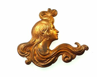 Raw brass stamping lady with very long hair